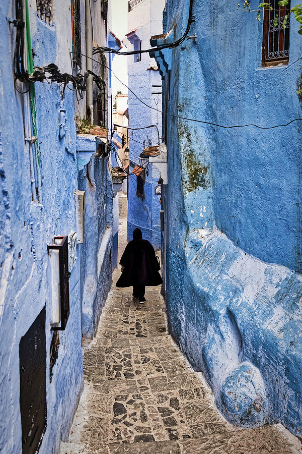 Man in Chefchaouen Alley - Morocco by Stuart Litoff