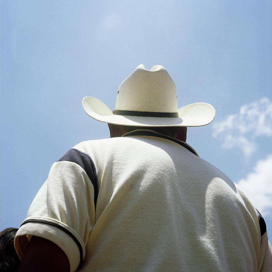 Man In Cowboy Hat, Rear View Photograph by Russell Monk