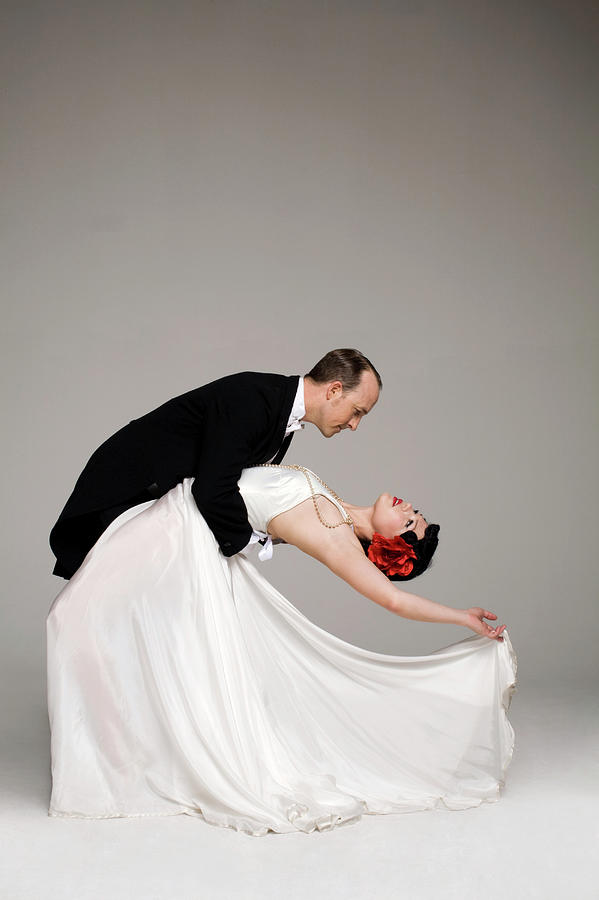 Man In Tuxedo Dipping Woman In White Photograph by Allison Michael Orenstein