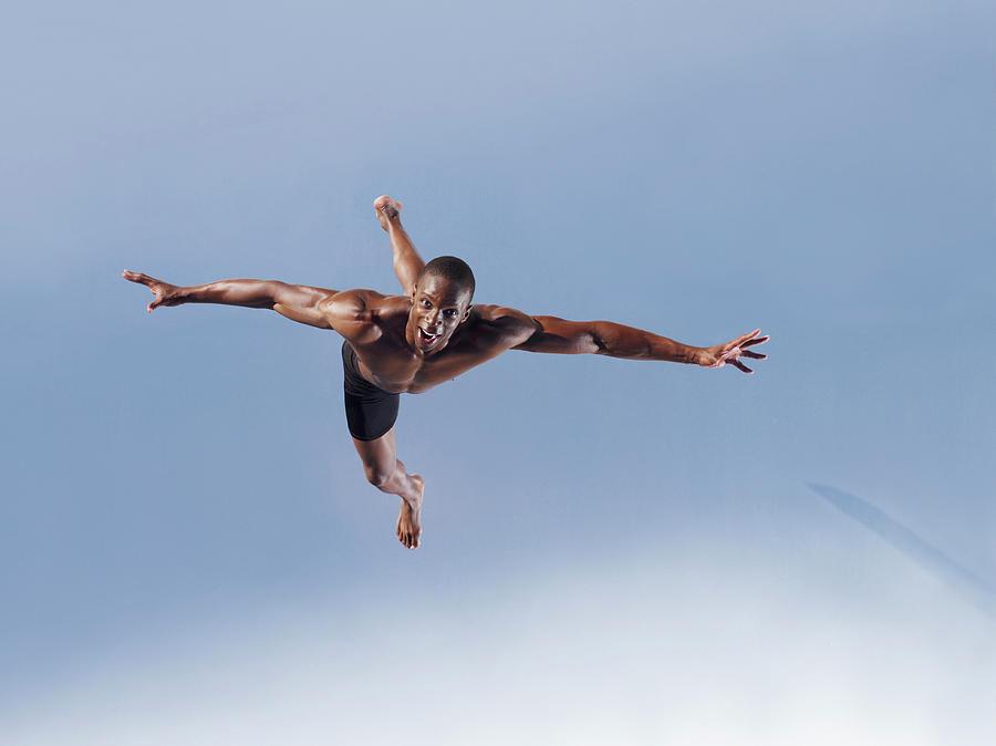 Man Jumping Photograph by Martin Barraud