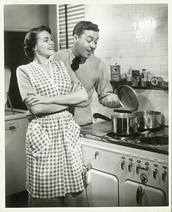 Man Looking Into Pot In Domestic Photograph by George Marks
