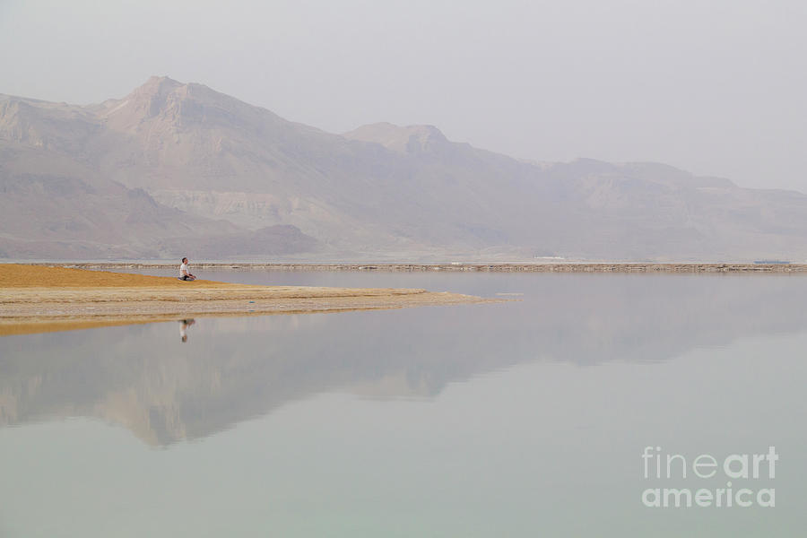 Man Meditating On Sunrise Beach Of The Dead Sea Photograph
