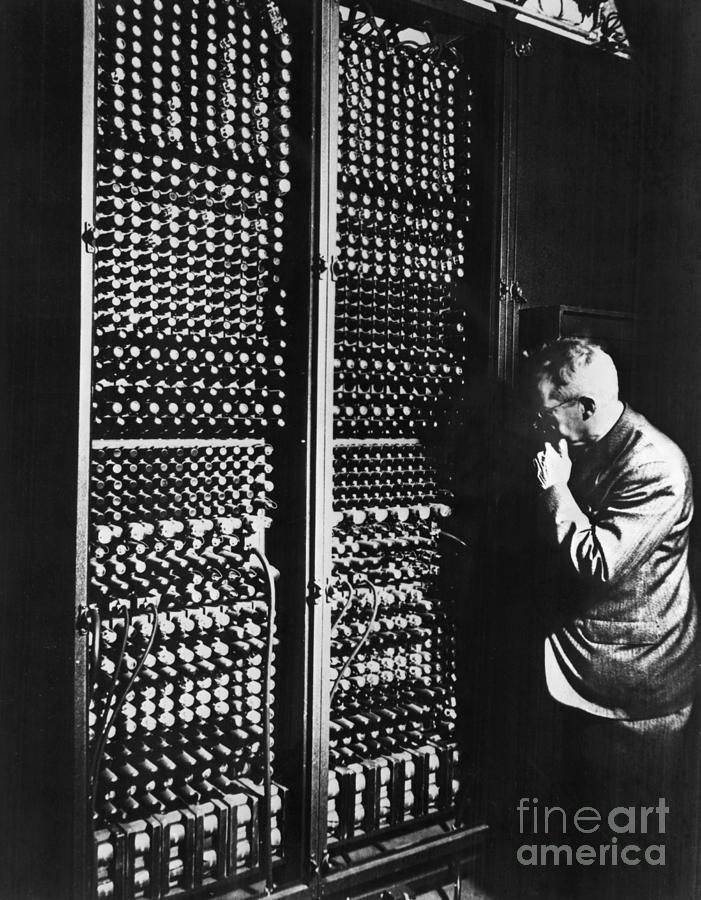 Man Next To Huge Eniac Computer Wcords Photograph by Bettmann