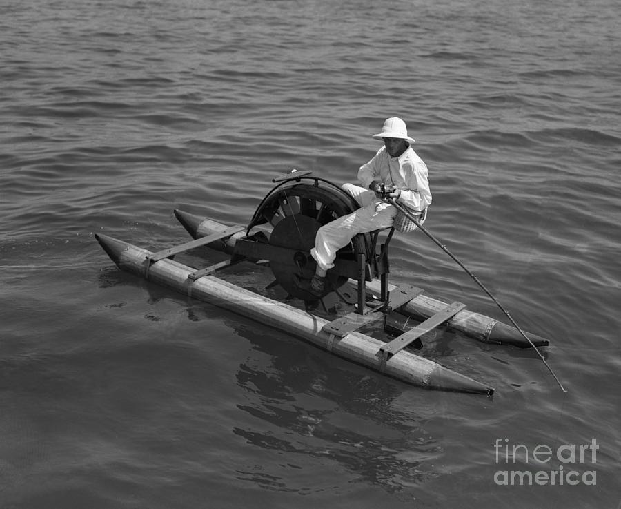 Man On Paddleboat Fishing Photograph by Bettmann