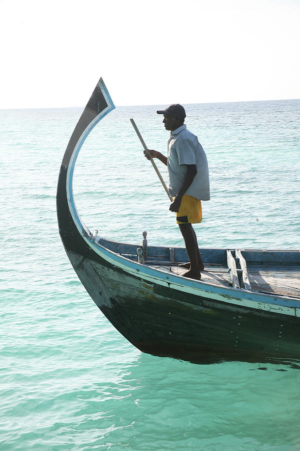 Man On Prowl Of Old Fishing Boat Photograph by Win-initiative