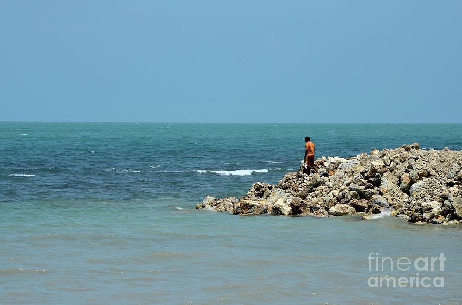 Man Photograph - Man On Rocks Looks Out To Ocean From Rocky Beach Jaffna Peninsula Sri Lanka by Imran Ahmed