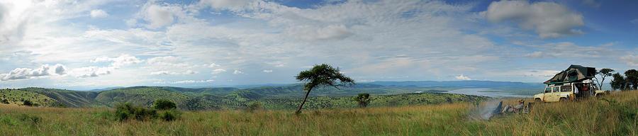 Man Overlooking A Savannah In Rwanda Photograph by Rollingearth
