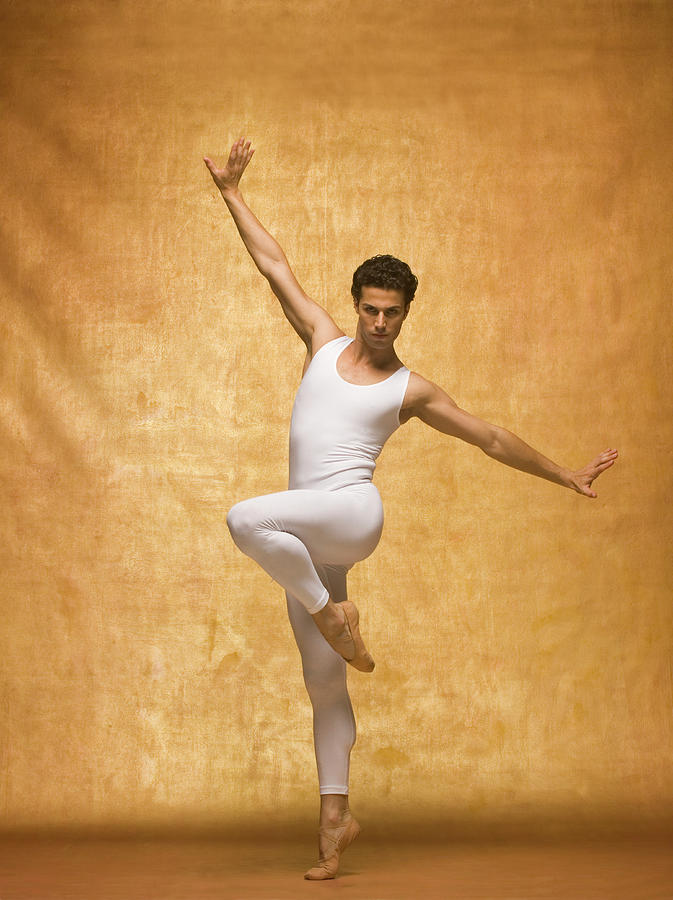 Man Performing Ballet Pose With Arms Photograph By Pm Images