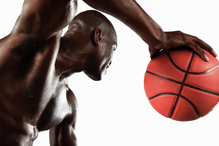 Man Playing Basketball Photograph by Moof