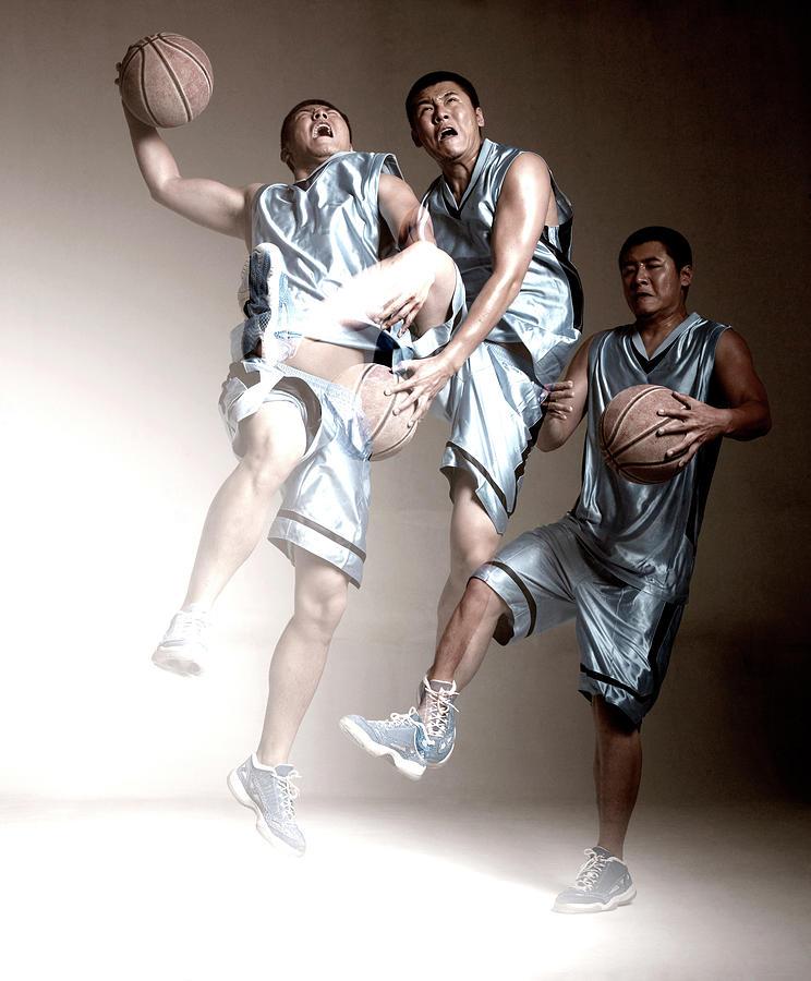 Man Playing Basketball Photograph by Ting Hoo