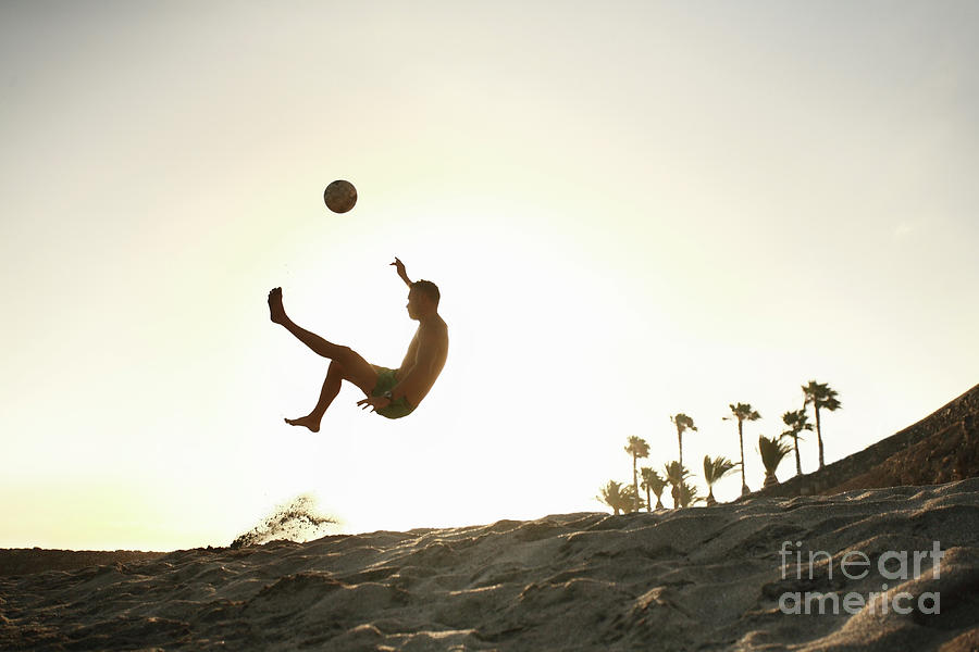 Man Playing Beach Soccer At Sunset Photograph by Stanislaw Pytel