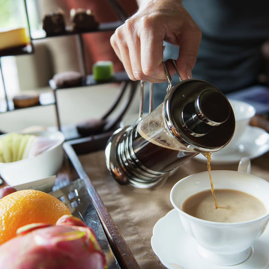 Man Pouring Coffee Into A Cup From A Photograph by Keith Levit / Design Pics