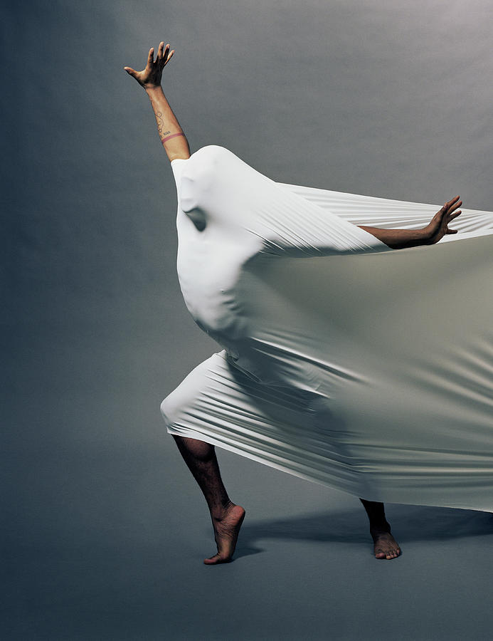 Man Pressing Into Fabric, Arms Extended Photograph by Pm Images
