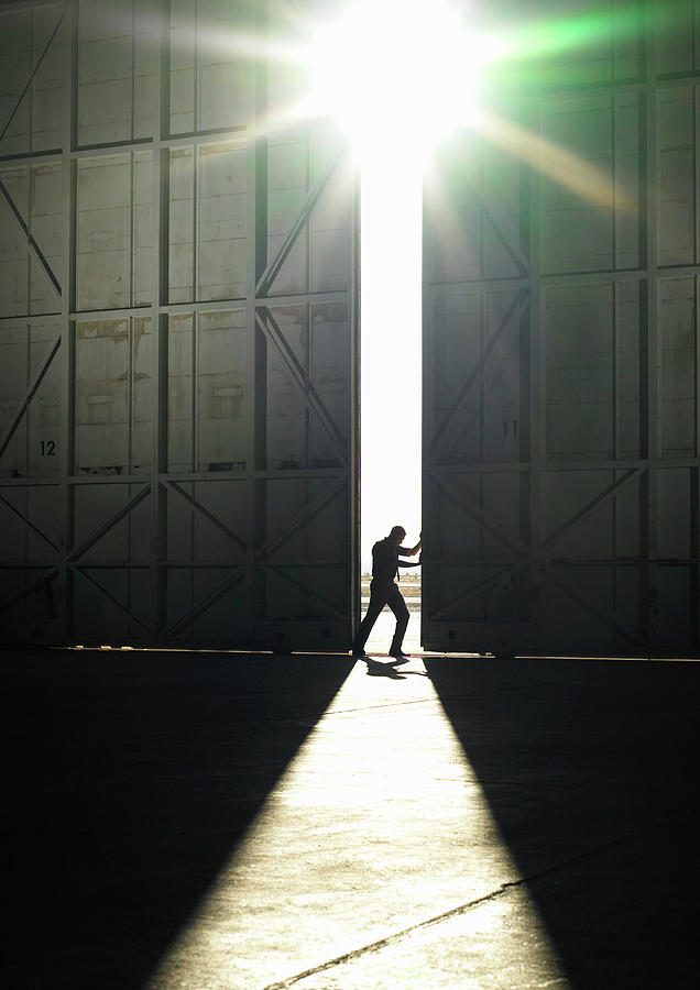 Man Pushing Door Open Photograph by Ryan Mcvay