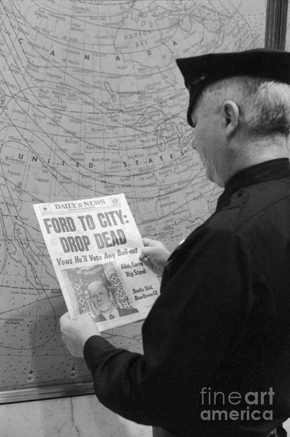 Man Reading Newspaper Headline Photograph by Bettmann