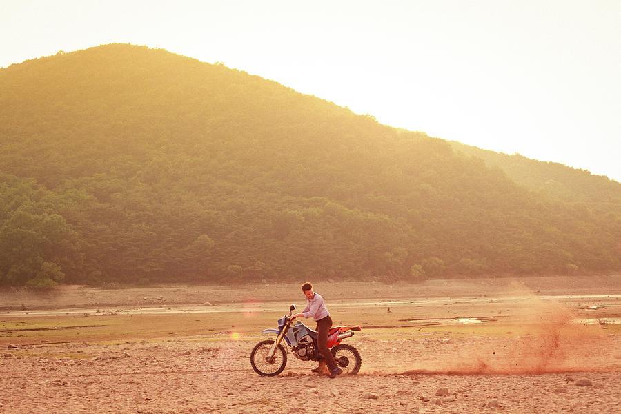 Man Riding Dirt-bike In Dress Shirt And Photograph by Greg Samborski