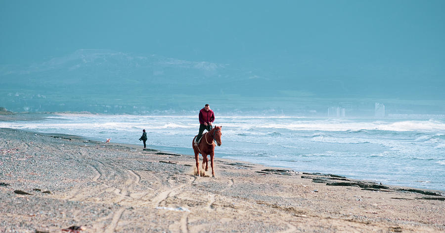 Cyprus Photograph - Man Riding On A Brown Galloping Horse On Ayia Erini Beach In Cyp by Iordanis Pallikaras