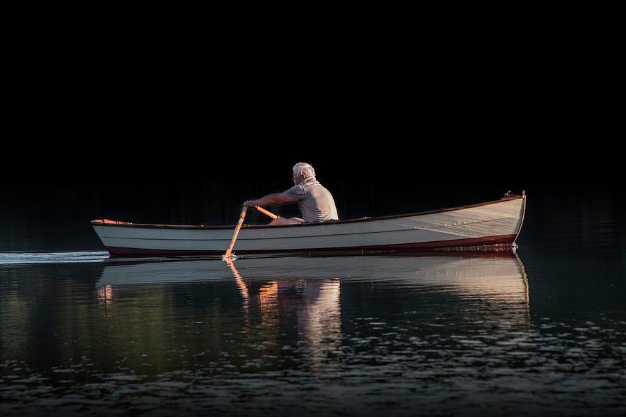 Man rowing on Stoney Lake at Sunrise by Randall Nyhof