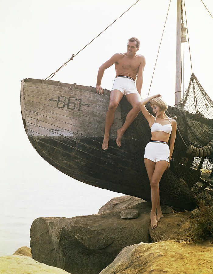 Man Sitting Boat, Woman Standing Beside Photograph by Tom Kelley Archive