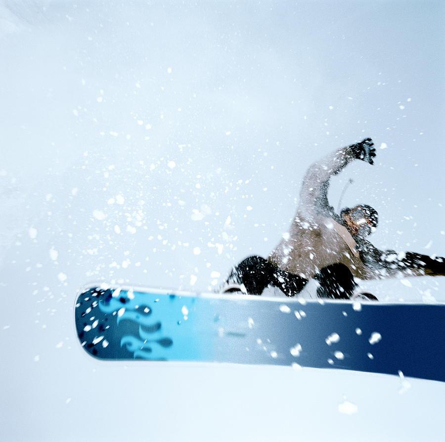 Man Snowboarding, Mid-jump. Low Angle Photograph by Martin Barraud
