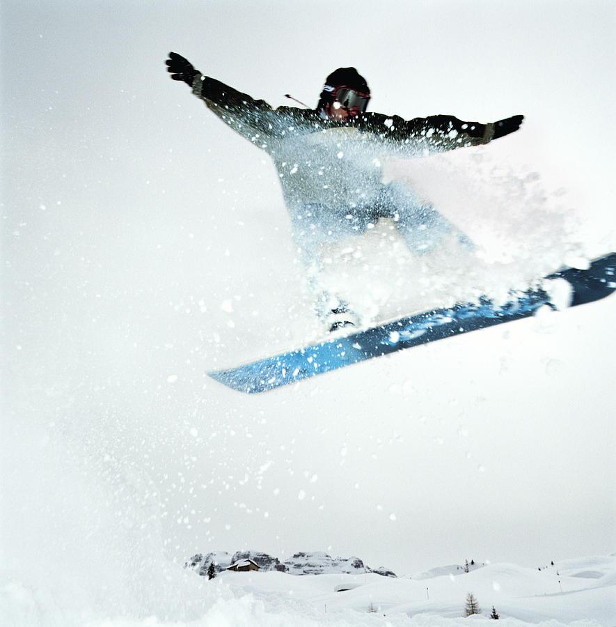 Man Snowboarding, Mid-jump Photograph by Martin Barraud