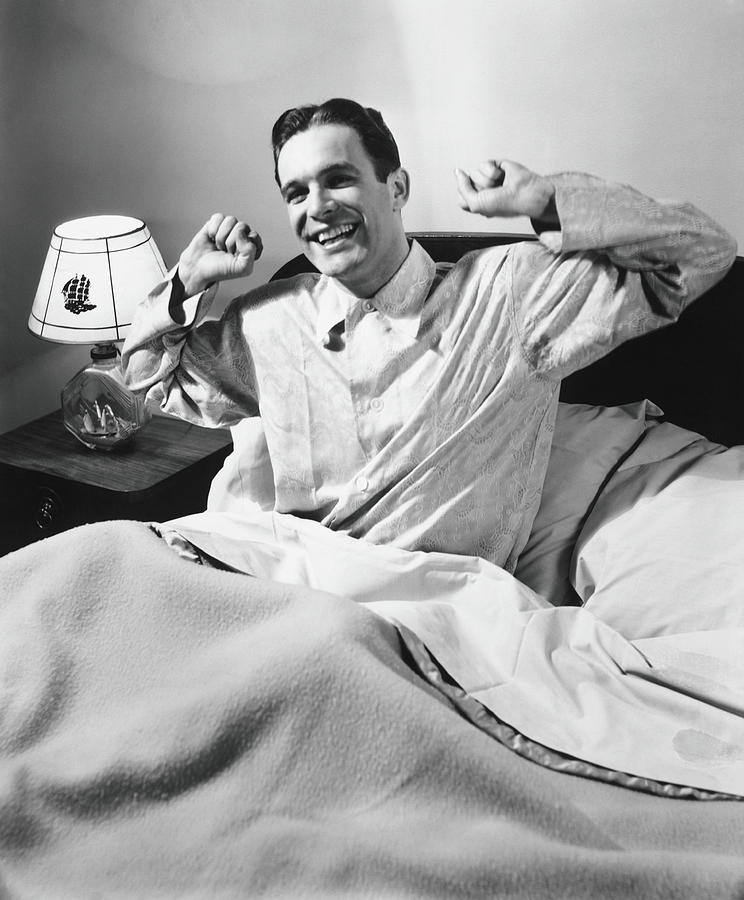 Man Stretching In Bed, B&w Photograph by George Marks