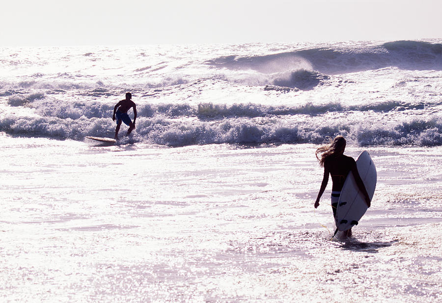 Man Surfing On Sea, Woman Walking With Photograph by Johner Images