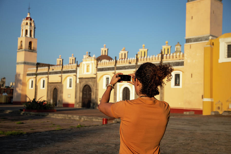 Mexico Photograph - Man Taking Photograph With Iphone To A Catholic Church In Mexico by Cavan Images