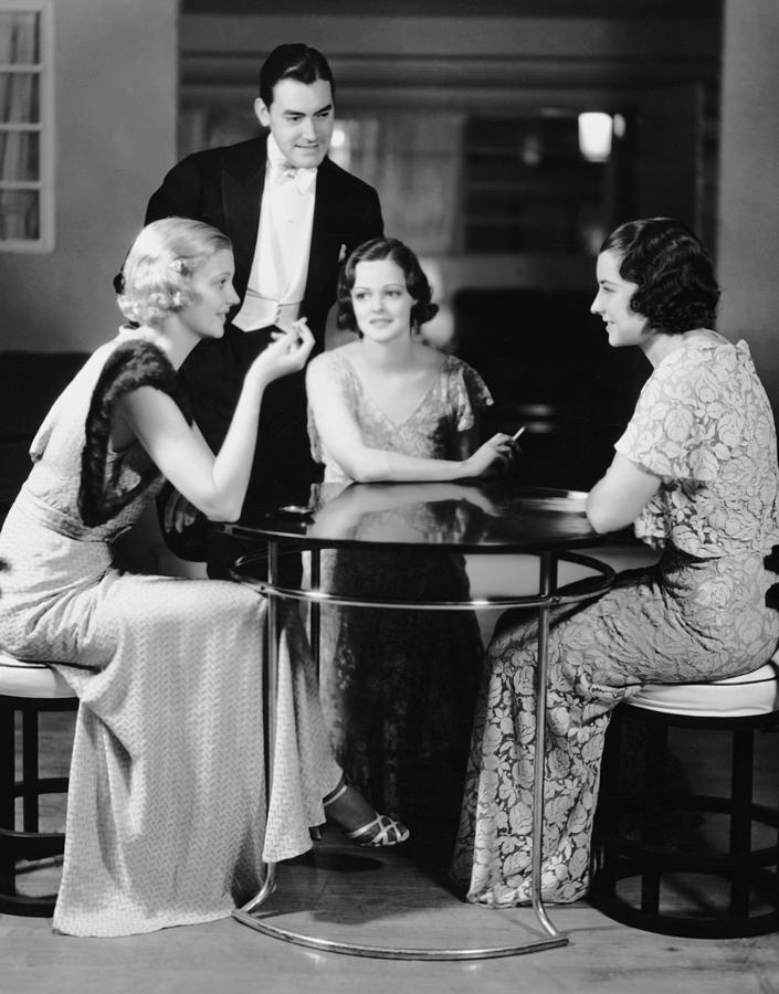 Man Talking With Three Women In Evening Photograph by George Marks