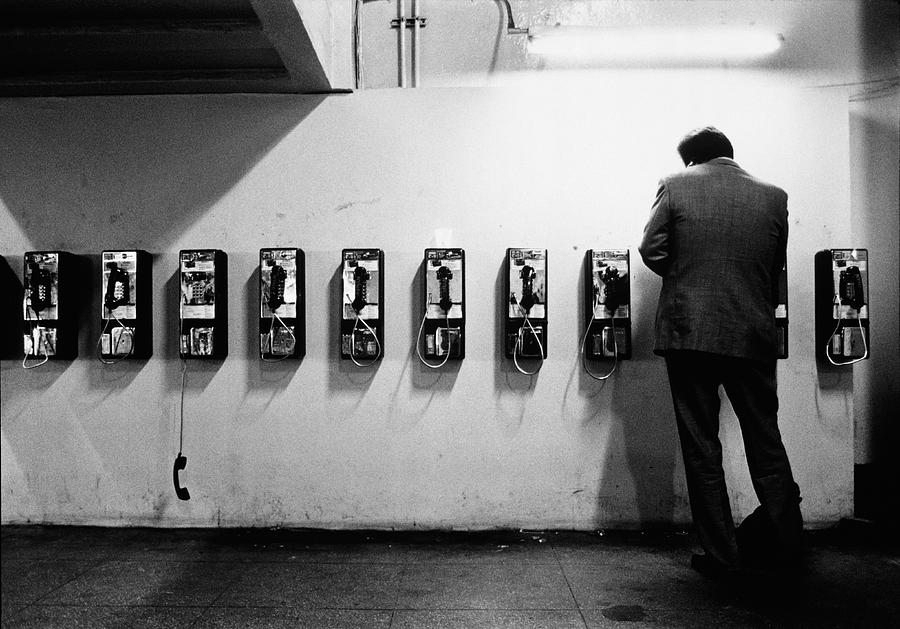 Man Using Public Telephone,grand Photograph by Eric Larrayadieu