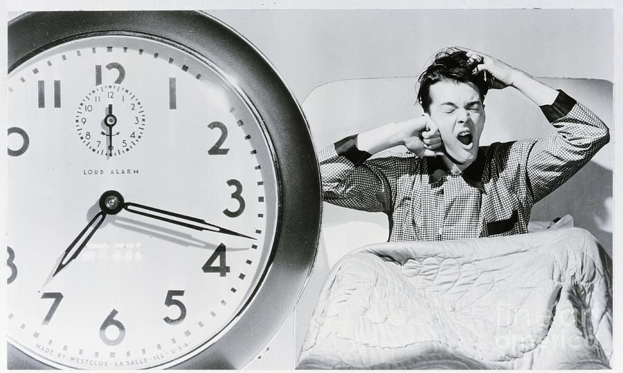 Man Waking Up To Alarm Clock Photograph by Bettmann