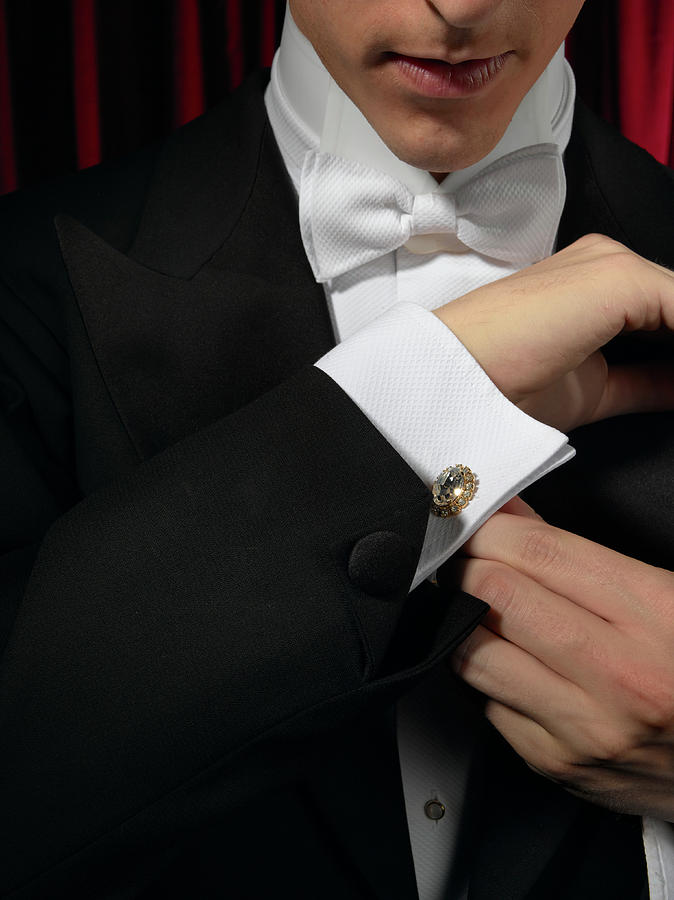Man Wearing Tuxedo, Adjusting Cufflink Photograph by Kelvin Murray
