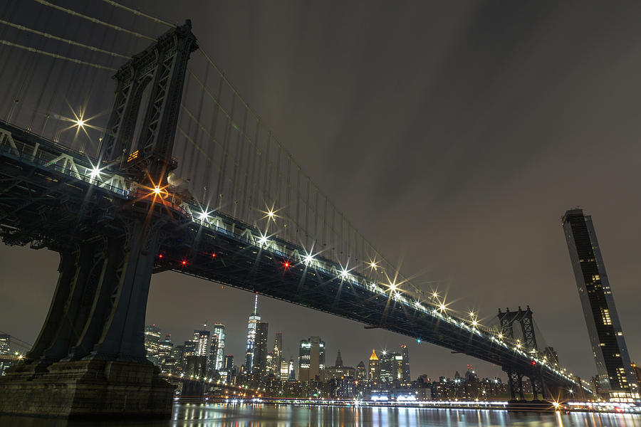 Manhattan Bridge Skyline at Night by John Daly