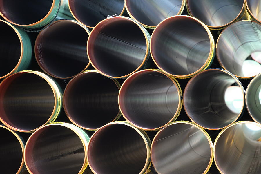 Many Steel Pipes In Large Stack Photograph by Kozmoat98