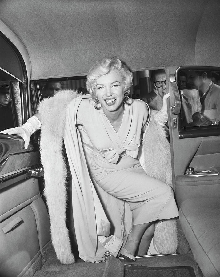 Marilyn Monroe Boarding A Car Photograph by Bettmann