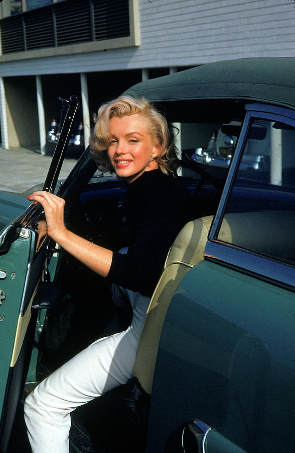Marilyn Monroe Getting Out Of A Car Photograph by Alfred Eisenstaedt