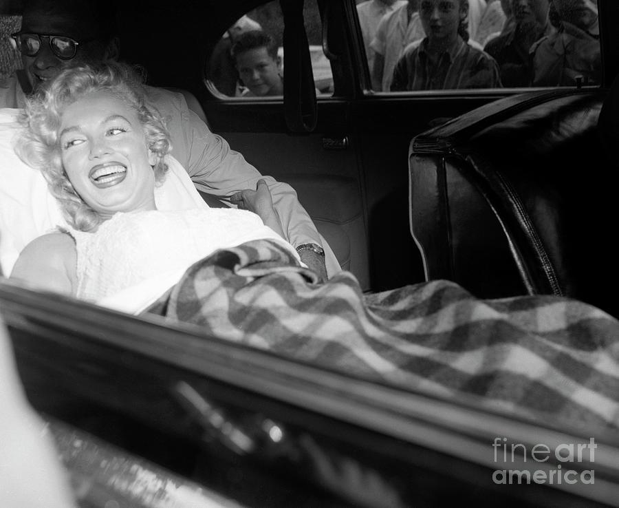 Marilyn Monroe Leaves The Hospital Photograph by Bettmann