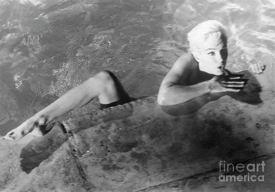 Marilyn Monroe Swimming Nude Photograph by Bettmann