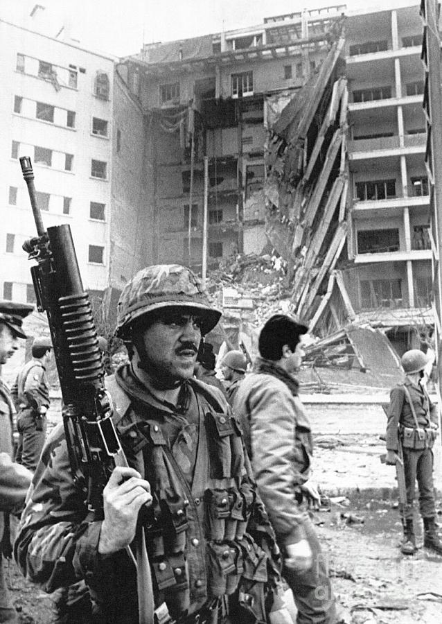 Marine Stands Guard At Bombed Building Photograph by Bettmann