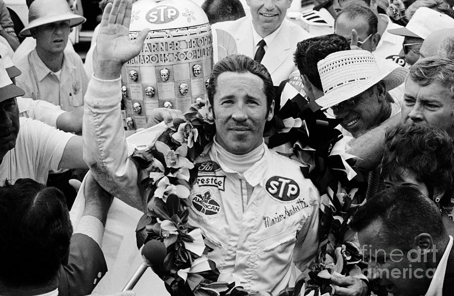 Mario Andretti Bedecked With Flowers Photograph by Bettmann