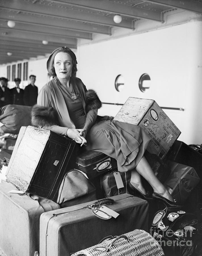 Marlene Dietrich On Boat, On Luggage Photograph by Bettmann