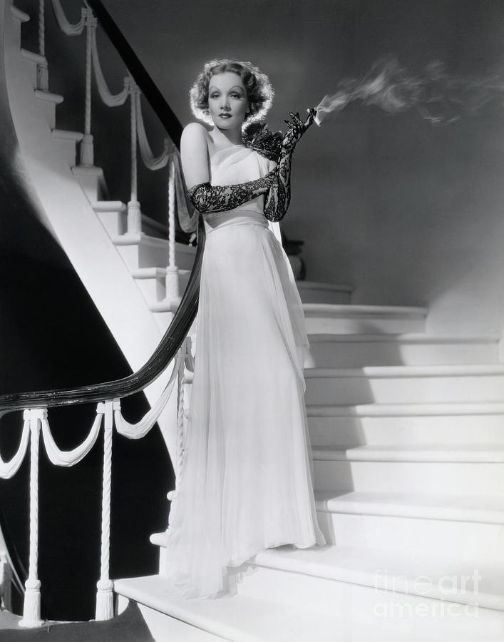 Marlene Dietrich Smoking On Staircase Photograph by Bettmann
