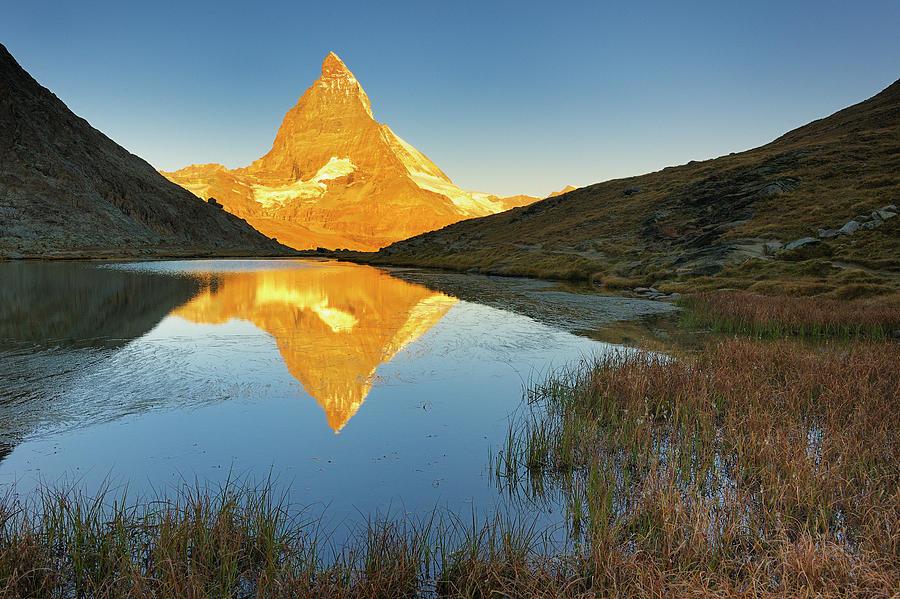 Matterhorn Reflected In Riffelsee Lake Photograph by Cornelia Doerr