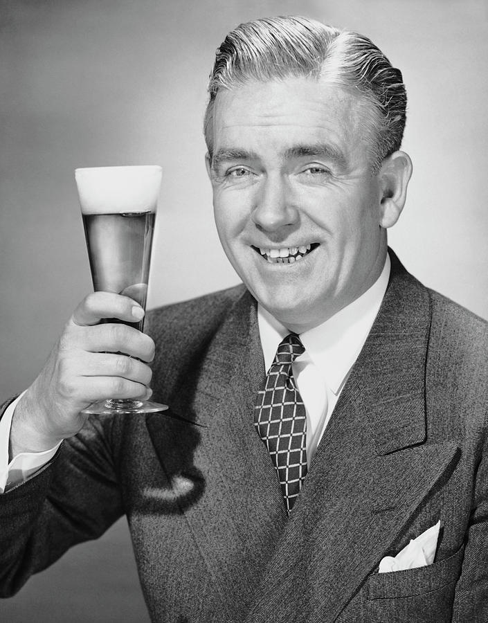 Mature Businessman W Beer Photograph by George Marks