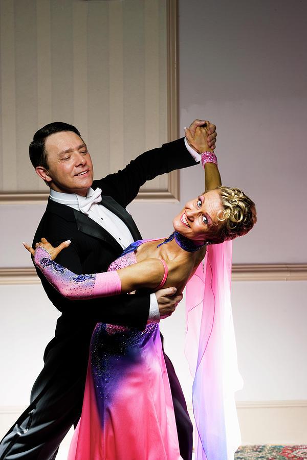Mature Couple Ballroom Dancing, Smiling Photograph by Alexander Nicholson