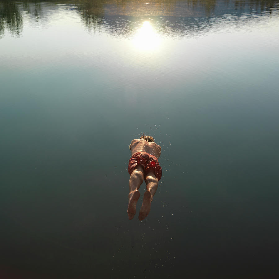Mature Man Diving Into Lake, Rear View Photograph by Ascent/pks Media Inc.