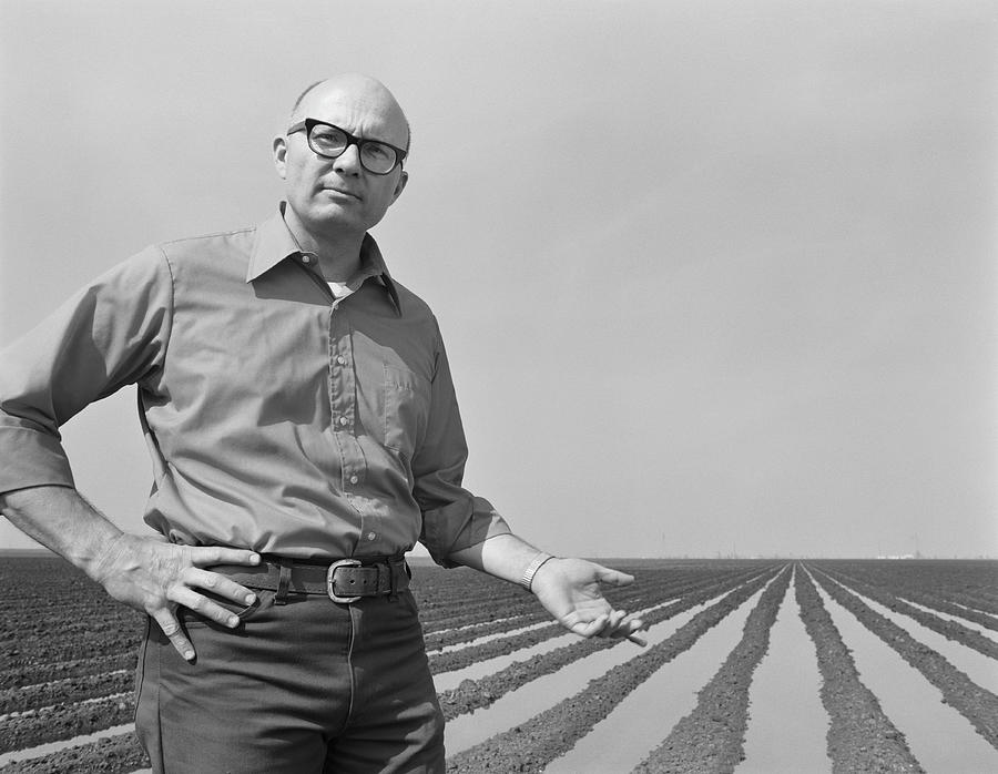 Mature Man Gesturing At Ploughed Field Photograph by Tom Kelley Archive