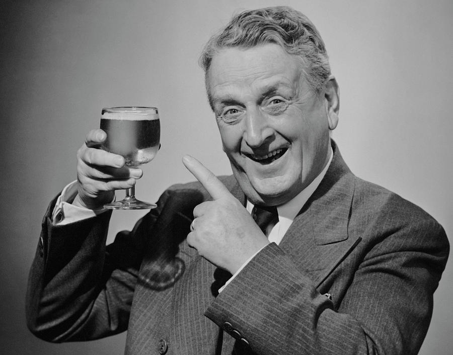 Mature Man Wglass Of Beer Photograph by George Marks