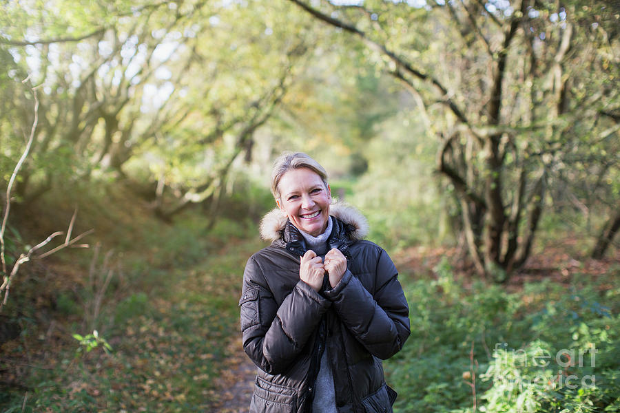 Autumn Photograph - Mature Woman In Sunny Autumn Woods by Caia Image/science Photo Library
