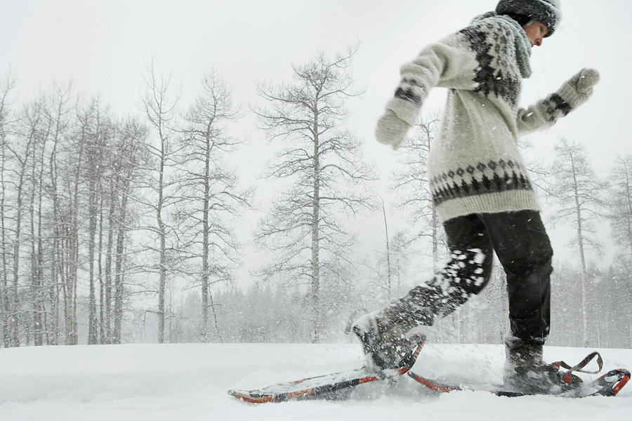 Mature Woman Snowshoeing Photograph by Thomas Northcut